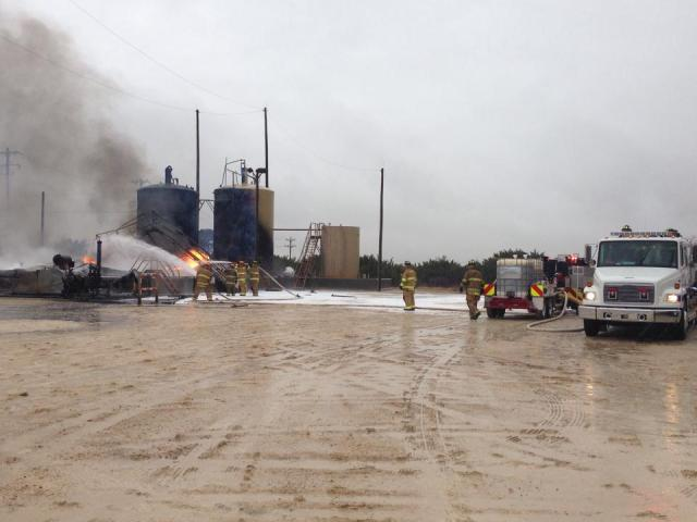 SCFD using it's foam trailer to extinguish a gas well explosion on CR 308. Six out of eight tanks caught fire after a lightning strike.